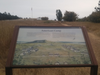 View with the existing buildings today and drawing of the camp when occupied. San Juan National Historical Reserve.