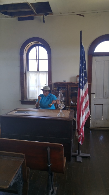 Bev being the teacher at the Lower Fox Creek Schoolhouse. Tallgrass Prairie National Preserve.
