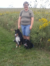 Rhonda, Kip, and Kellie next to some Goldenrod and Common Sunflowers. Tallgrass Prairie National Preserve.